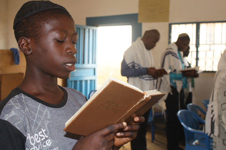 Kadmiel Abhor, a 14-year-old Igbo Jew, prays at the Ghihon Synagogue in Abuja, Nigeria. (Photo courtesy of Chika Oduah.)