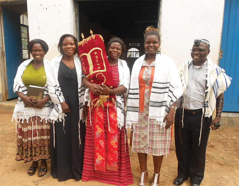 Women from the Abayudaya Jewish community of Uganda celebrate the first adult bat mitzvah in the community, December 2012. With them is Rabbi Gershom Sizomu. (Photo courtesy of Kulanu, Inc., New York.)