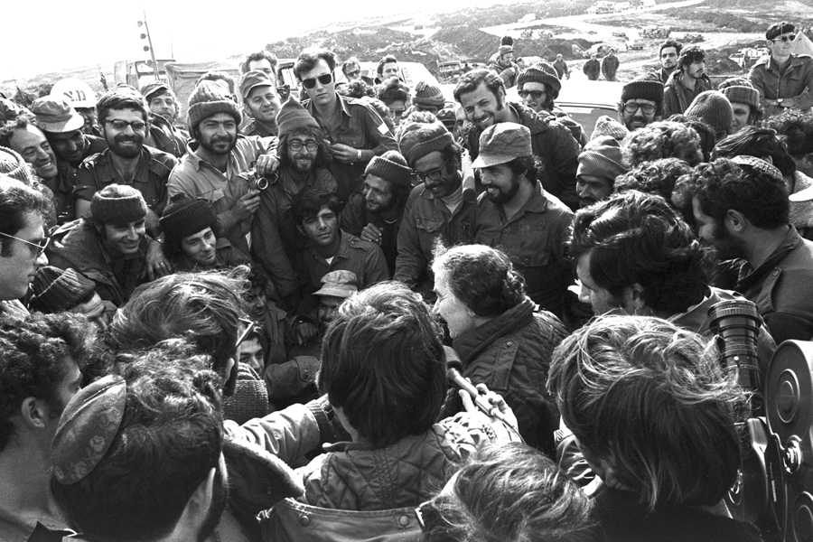 Prime Minister Golda Meir with Israeli troops in the Golan Heights during the Yom Kippur War, November 1973. (Photo by Ron Frenkel, courtesy of Government Press Office, Israel.)
